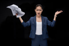 Portrait of angry asian businesswoman holding documents stock photos