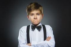 Portrait of angry boy on gray background. Negative human emotion, facial expression. Closeup.  royalty free stock photos