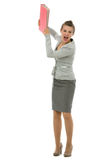 Portrait of angry business woman throwing folder Stock Image