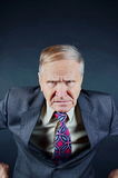 Portrait of Angry businessman. Fists on hips Royalty Free Stock Photography