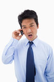 Portrait of an angry businessman making a phone call Royalty Free Stock Image