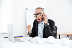 Portrait of a angry businessman with mobile phone Stock Photography