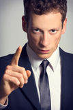 Portrait of a angry businessman pointing finger Stock Photo