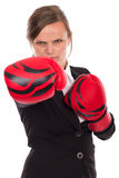 Portrait of angry businesswoman with boxing gloves punching Royalty Free Stock Photography
