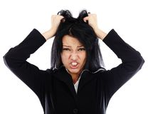 Portrait of an angry businesswoman pulling her hair. Frustrated businesswoman in closeup pose isolated on white background Royalty Free Stock Photos