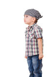 Angry capricious preschool kid on white. Portrait of a angry capricious preschool kid in bandanna and shirt, isolated on white Royalty Free Stock Photography