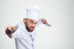 Portrait of angry chef cook holding knifes Stock Images