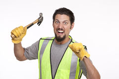 Portrait of an angry construction worker with a hammer stock images