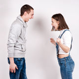 Portrait of an angry couple shouting each other against white background.  Stock Photo