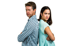 Portrait of angry couple standing back to back Stock Photography
