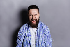 Portrait of angry crying bearded man Stock Images