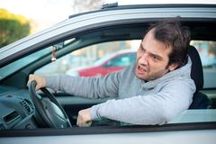 Portrait of angry driver at the wheel. Negative human emotions f Stock Photo