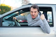 Closeup portrait of aggressive male driver honking in traffic ja Royalty Free Stock Photography