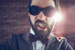 Portrait of angry fashionable man wearing sunglasses Stock Images