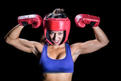 Portrait of angry female boxer flexing muscles Stock Image
