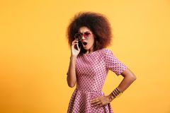 Portrait of an angry furious afro american woman Stock Images