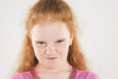 Portrait of Angry and Furious Little Caucasian Redhaired Girl Stock Photos