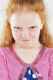 Portrait of Angry and Furious Little Caucasian Redhaired Girl Royalty Free Stock Photos