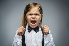 Portrait of angry girl with hand up yelling isolated on gray background. Negative human emotion, facial expression Stock Images