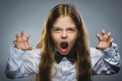 Portrait of angry girl with hand up yelling isolated on gray background. Negative human emotion, facial expression Royalty Free Stock Image