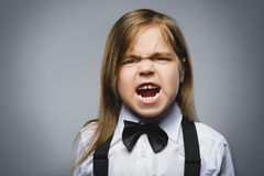 Portrait of angry girl isolated on gray background. Negative human emotion, facial expression. Closeup Royalty Free Stock Photography