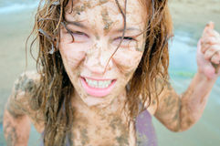 Portrait of an angry girl in the mud. Stock Photos