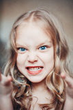 Portrait of angry little girl. Portrait of angry capricious little girl shouting Stock Photography