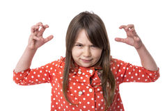 Portrait of an angry little girl holding her arms raised Stock Image