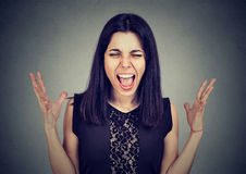 Portrait angry mad young woman screaming Stock Photos