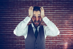 Portrait angry man with head in hands Royalty Free Stock Images