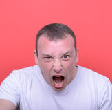 Portrait of angry man screaming against red background Royalty Free Stock Image