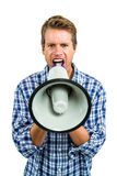 Portrait of angry man shouting through megaphone Royalty Free Stock Photography