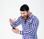 Portrait of angry man shouting on smartphone Stock Image