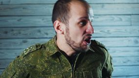 Portrait of angry officer soldier. The crazy captain of the army is swearing and yelling. stock footage