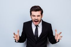 Portrait of angry overworked businessman sreaming in rage becaus royalty free stock image