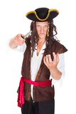 Portrait Of A Angry Pirate. Angry Pirate Holding Knife On His Neck Over White Background Royalty Free Stock Photo
