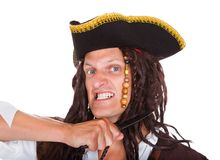 Portrait Of A Angry Pirate. Angry Pirate Holding Knife On His Neck Over White Background Stock Photo