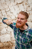Portrait of angry red haired hipster man with blue plaid shirt Royalty Free Stock Image
