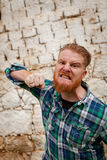 Portrait of angry red haired hipster man with blue plaid shirt Stock Images