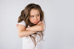 Portrait of angry and sad little girl isolated on white background. Children`s emotions Royalty Free Stock Image
