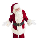 Portrait Of Angry Santa Claus Gesturing. While standing isolated over white background Royalty Free Stock Photo