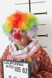 Portrait of angry senior clown during mug shot Royalty Free Stock Image