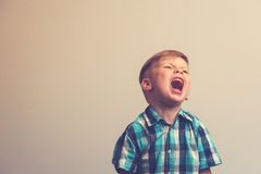 Portrait of angry shouting caucasian child Stock Photos