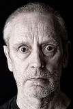 Portrait of an Angry and Surprised Man Stock Photo