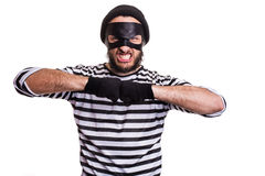 Portrait of a angry thief threaten with a fist. Isolated on white background Stock Photos