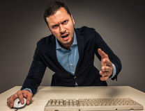 Portrait angry upset young man in blue shirt and jacket Royalty Free Stock Photo