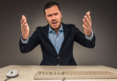 Portrait angry upset young man in blue shirt and jacket Royalty Free Stock Image