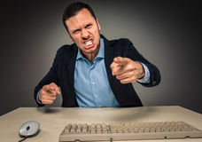 Portrait angry upset young man in blue shirt and jacket Stock Photography
