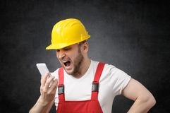 Construction worker shouting on the phone Stock Images
