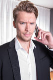 Portrait angry young business man in suit on the phone Royalty Free Stock Photography